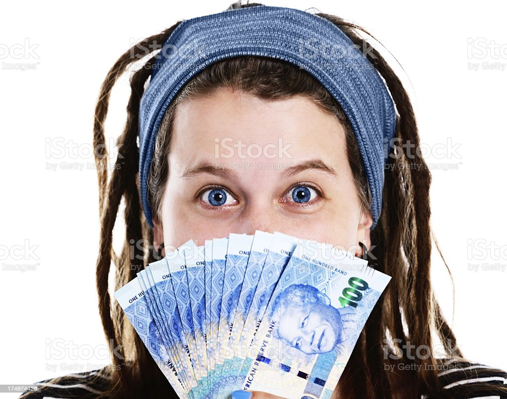 Smiling woman holding new hundred Rand South African Mandela banknotes stock photo