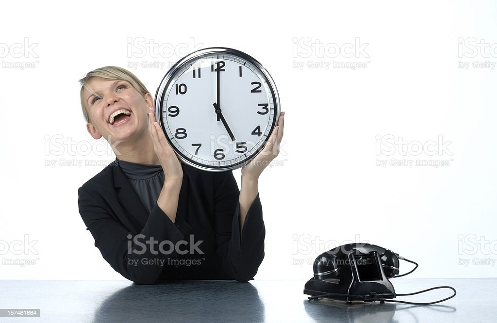 smiling woman holding office clock royalty-free stock photo