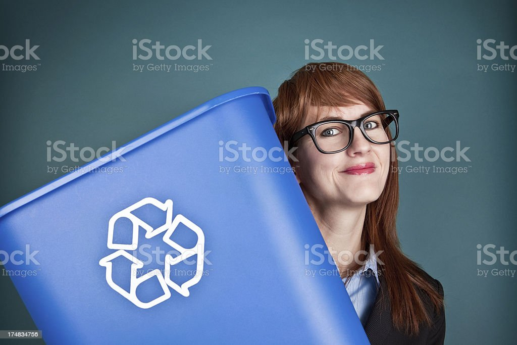 Smiling Woman Holding Recycling Can royalty-free stock photo