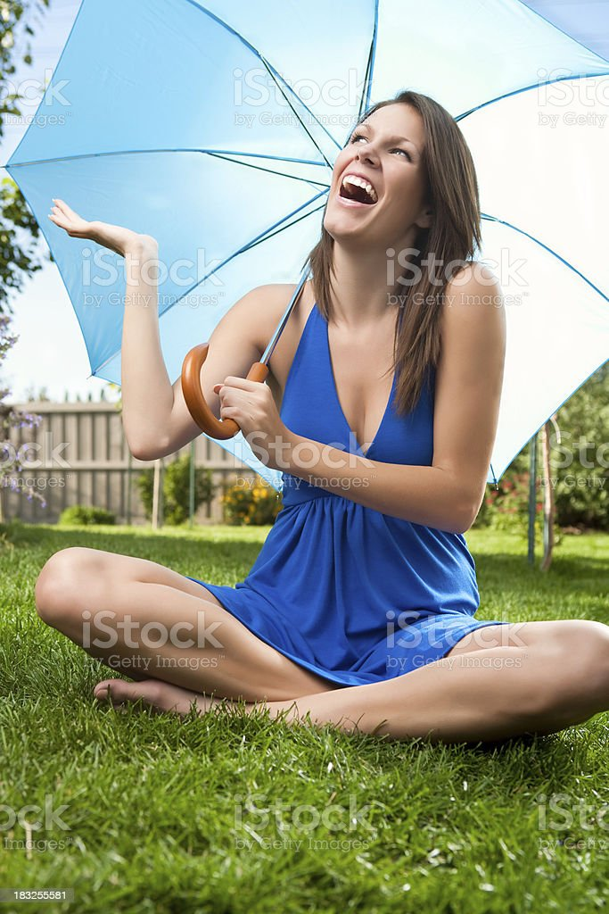 Smiling woman holding umbrella royalty-free stock photo