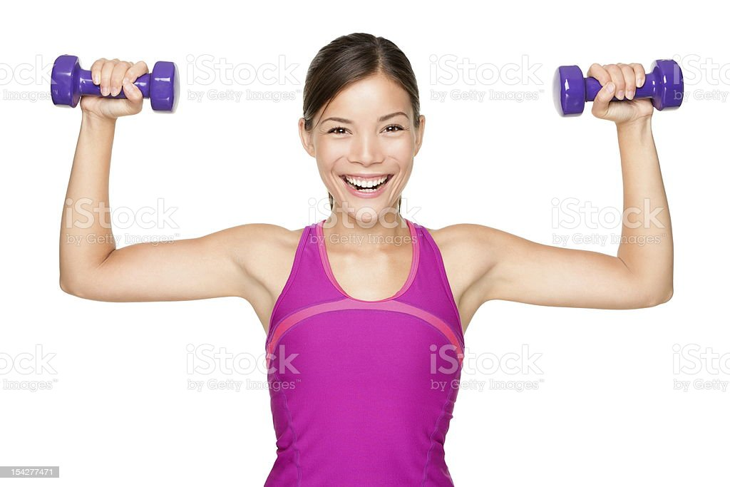 Smiling woman holding up fitness weights stock photo