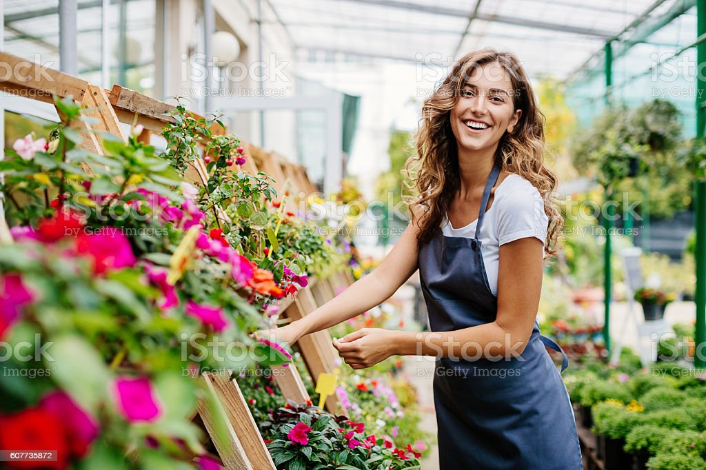 Smiling woman in a greenhouse stock photo