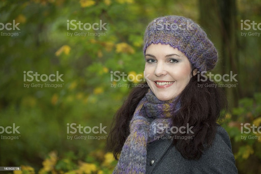 Smiling woman in a park stock photo