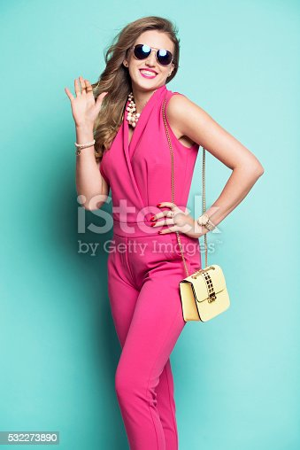 istock Smiling woman in a pink outfit 532273890