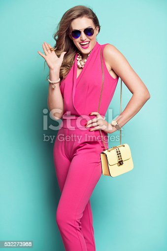 532274156 istock photo Smiling woman in a pink outfit 532273988