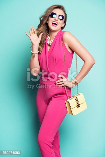532274156 istock photo Smiling woman in a pink outfit 532274090