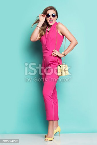 532274156 istock photo Smiling woman in a pink outfit 532274228