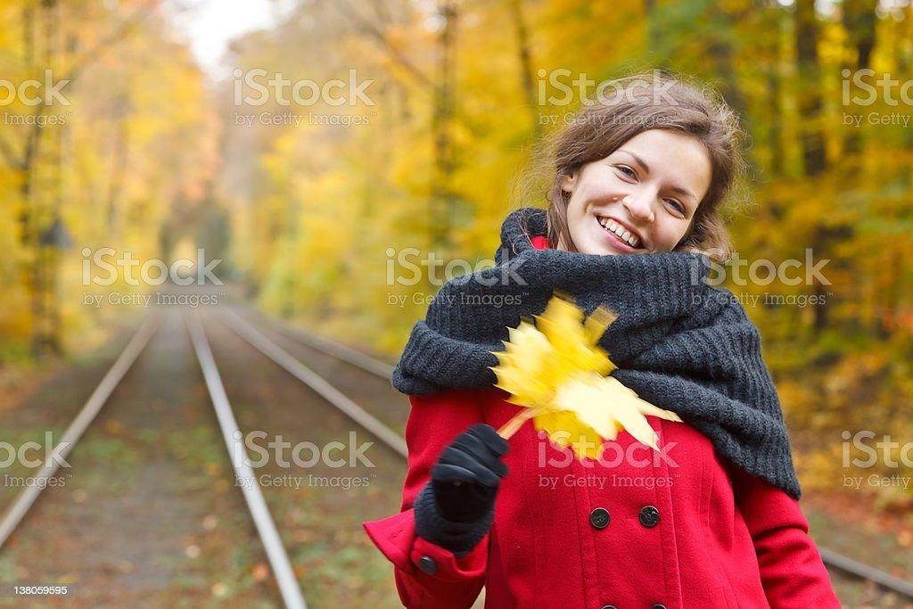Smiling woman in autumn park royalty-free stock photo