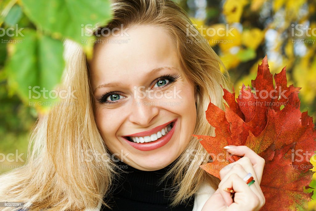 Smiling woman in autumnal mood royalty-free stock photo
