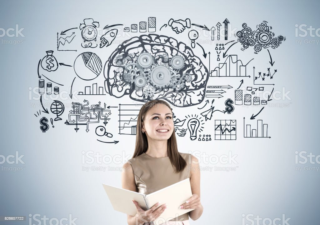 Smiling woman in beige and brain cogs stock photo