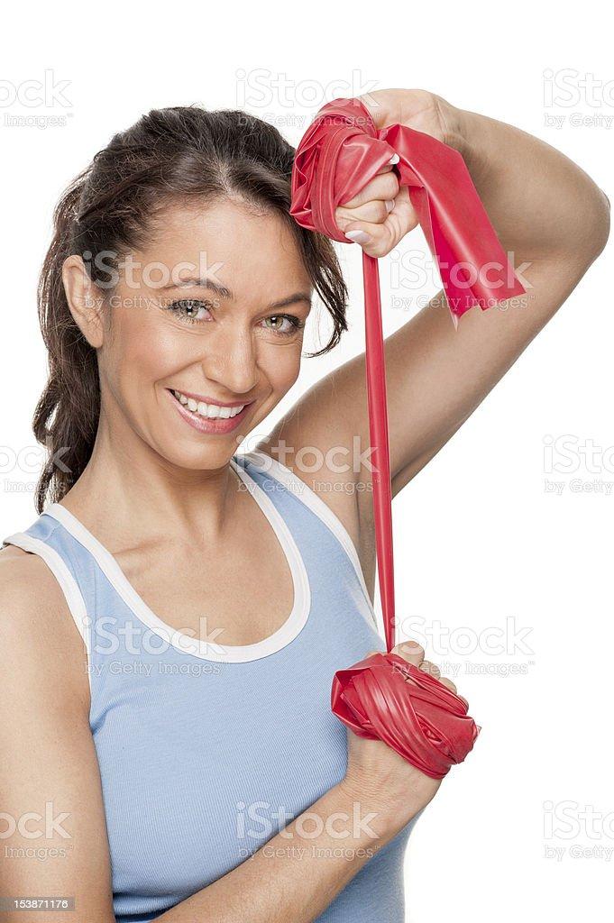 Mujer con rojo Banda de caucho - Foto de stock de Adulto libre de derechos