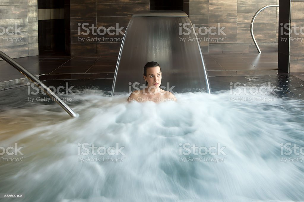 Smiling woman in bubbled water stock photo