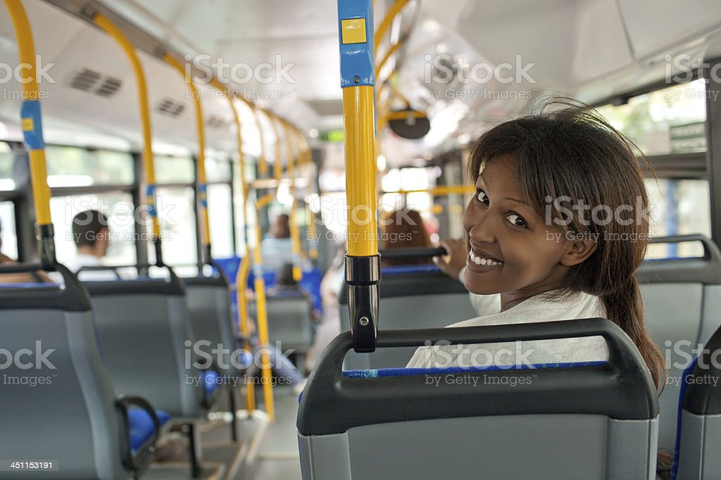 Smiling woman in bus. stock photo