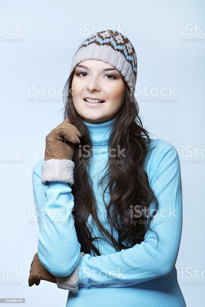 smiling woman in cap and mittens royalty-free stock photo