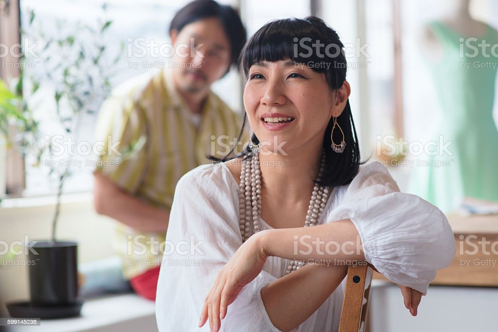 Smiling woman in design office stock photo