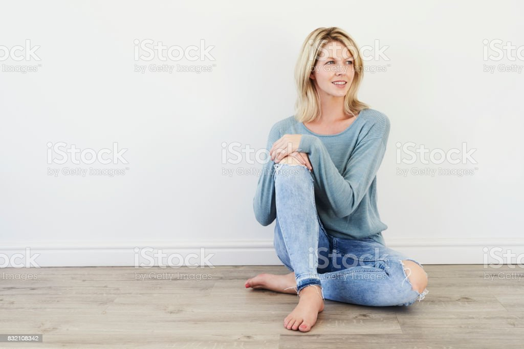 Smiling woman in jeans stock photo