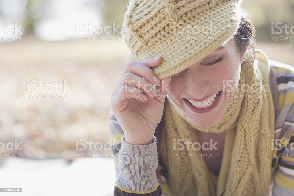Smiling woman in knit cap and scarf 免版稅 stock photo