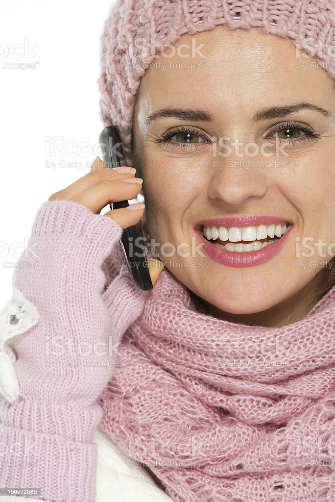 Smiling woman in knit winter clothing speaking mobile royalty-free stock photo