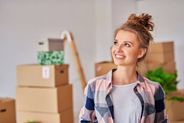 Smiling woman in new home stock photo