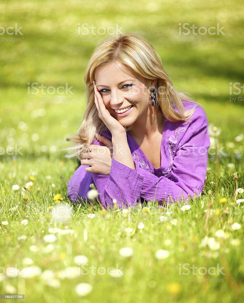 Smiling woman in park royalty-free stock photo