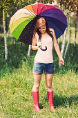 istock Smiling woman in rainy summer day 178879914