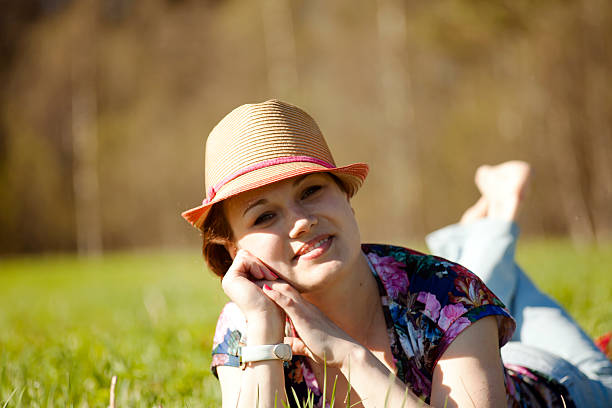 Smiling Woman in Straw Hat stock photo
