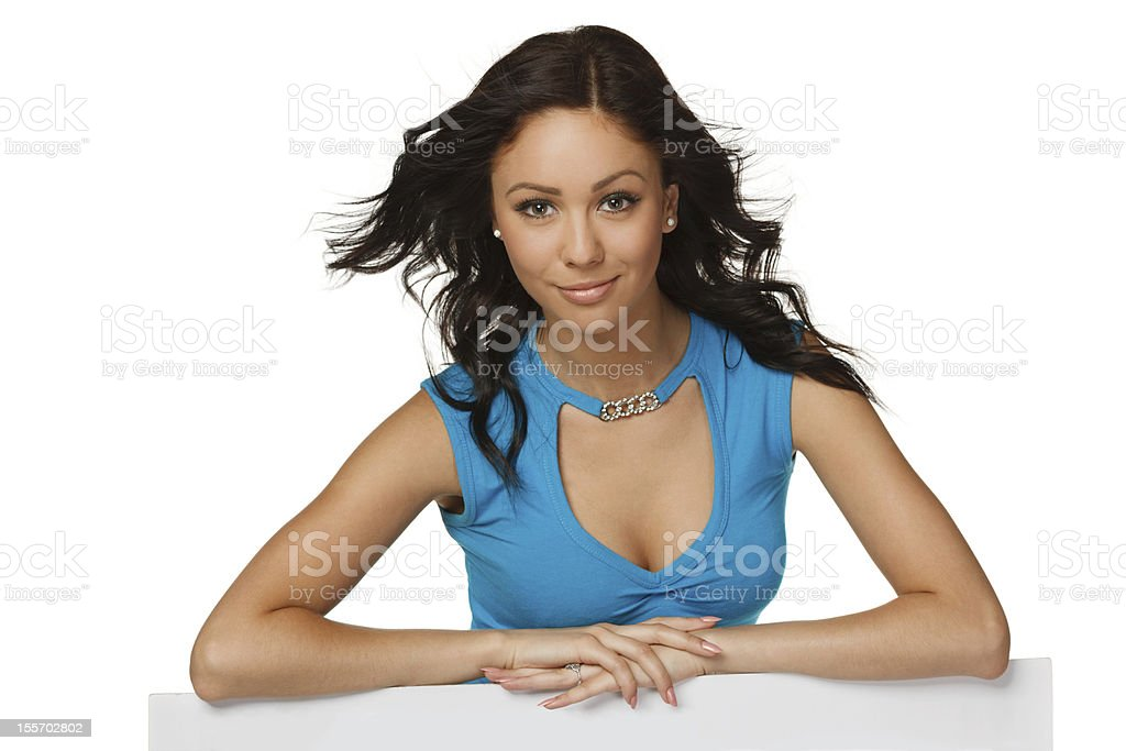 Smiling woman leaning on whiteboard royalty-free stock photo