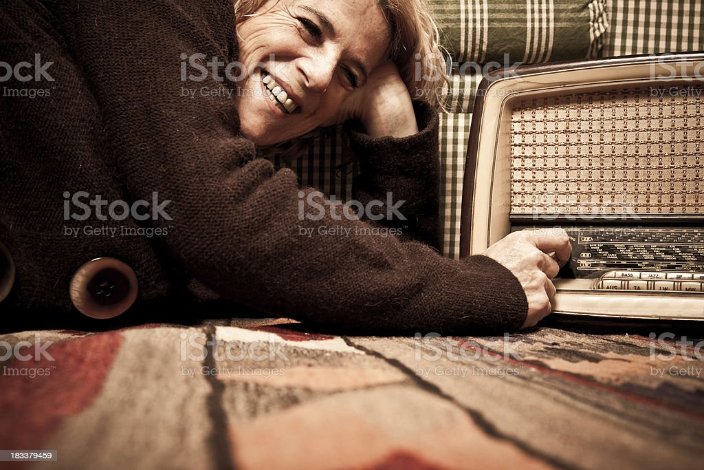 Smiling Woman Listening To The Radio stock photo