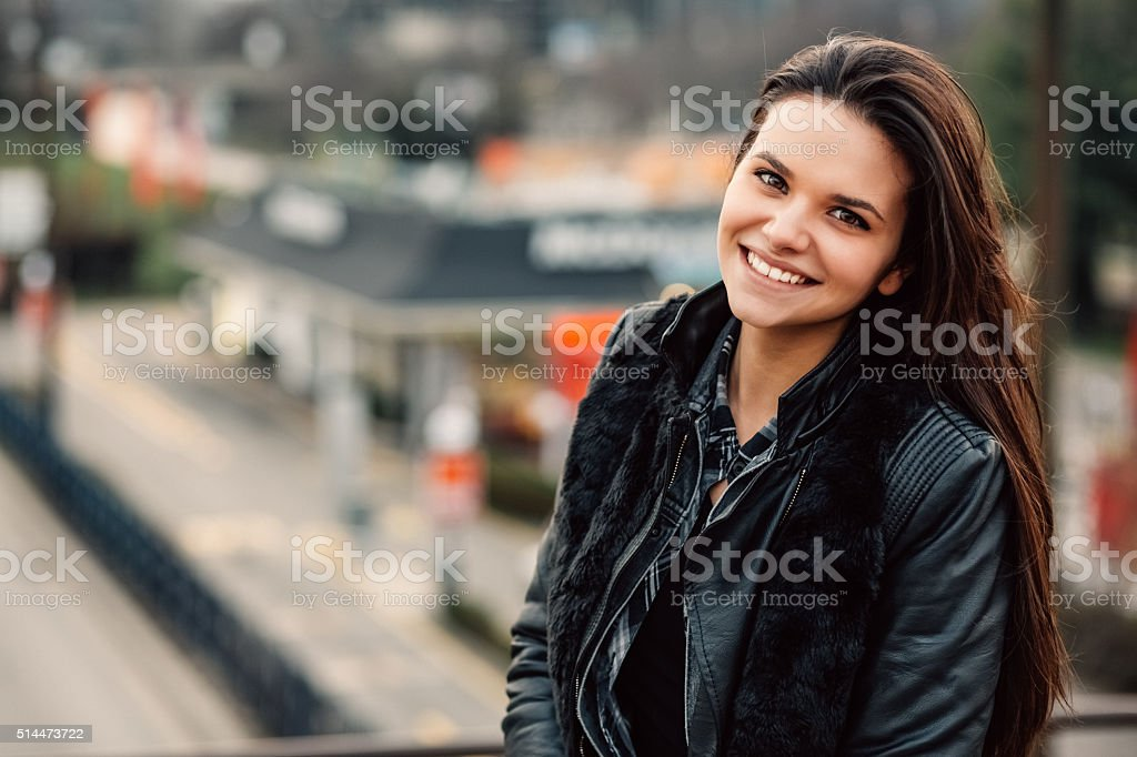Smiling woman looking at camera stock photo