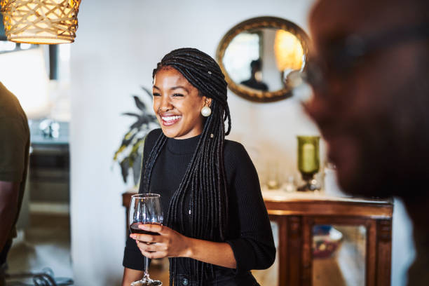 Smiling woman looking away while having wine stock photo