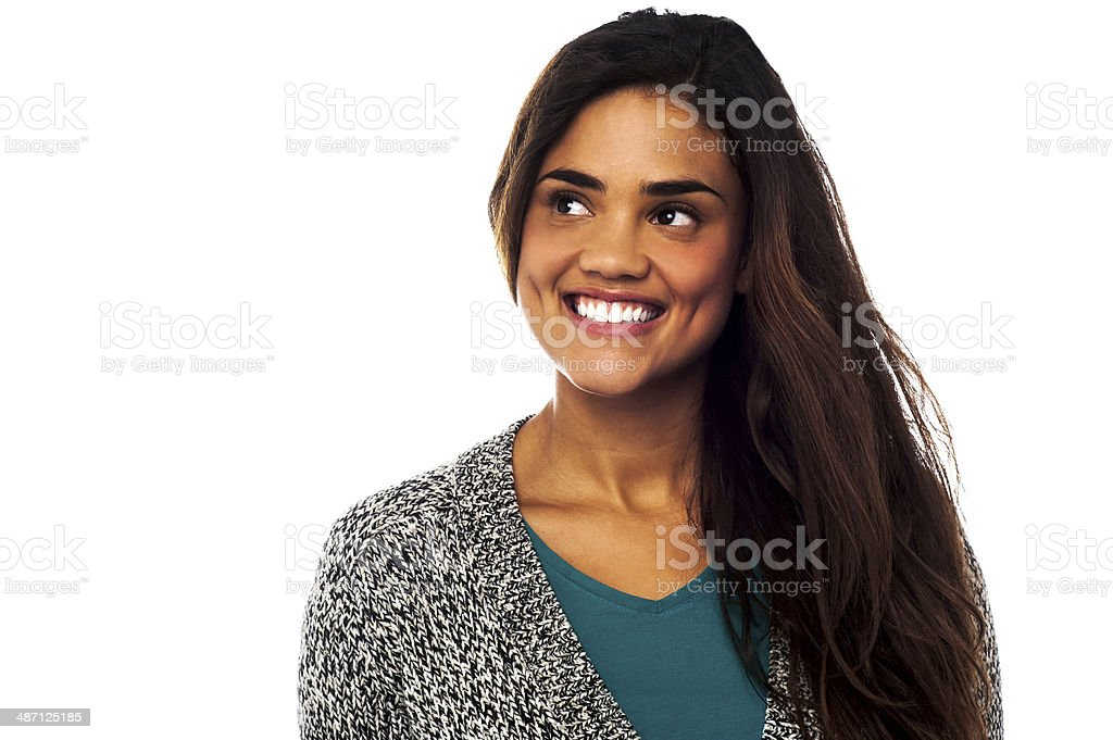 Smiling woman looking outside royalty-free stock photo