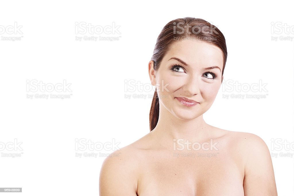 Smiling woman looking up to the side royalty-free stock photo