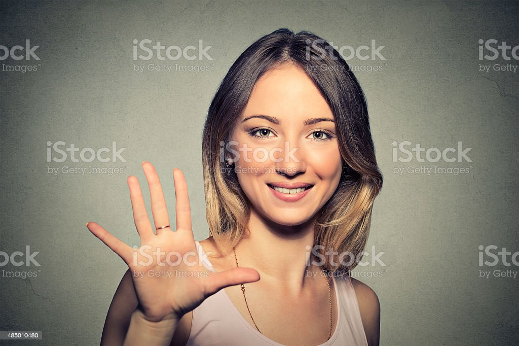 Smiling woman making high five gesture stock photo