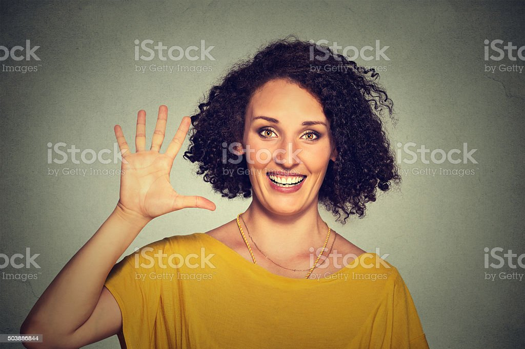 Smiling woman making high five with her hand stock photo