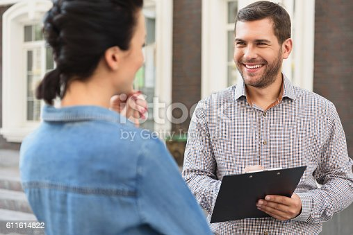 istock Smiling woman meeting with realtor 611614822
