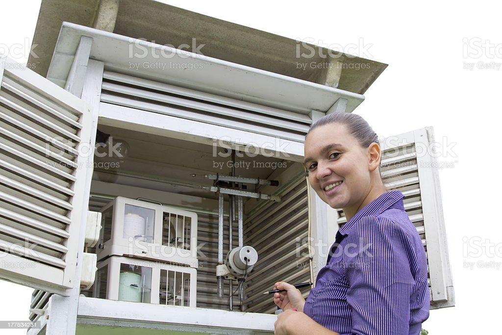 Smiling woman meteorologist reads meteodata royalty-free stock photo