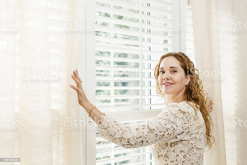 Smiling woman near window royalty-free stock photo