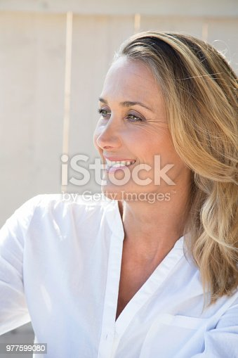 977601820 istock photo smiling woman of 40 years 977599080