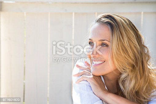portrait of a smiling blonde woman of 40 years