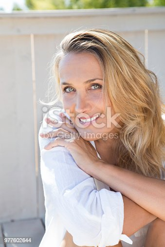977601820 istock photo smiling woman of 40 years 977602644