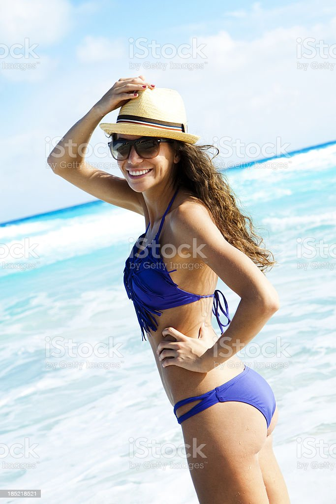 Smiling woman on beach stock photo