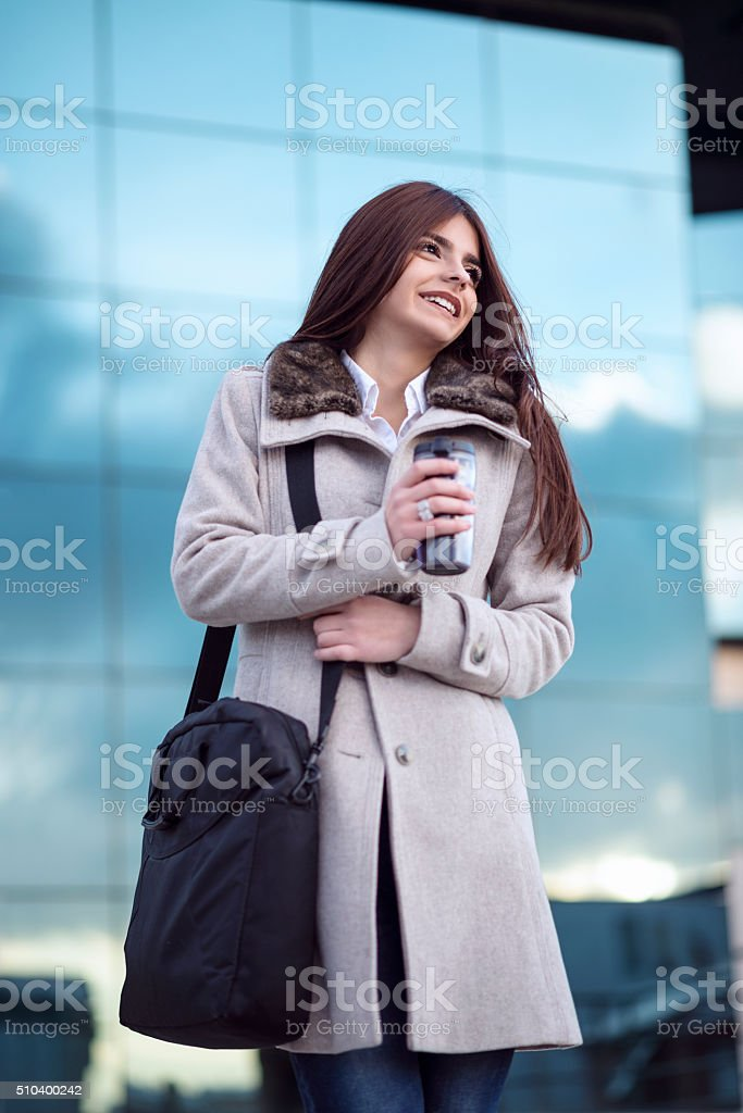Young attractive and smiling woman on coffe break in front of her...