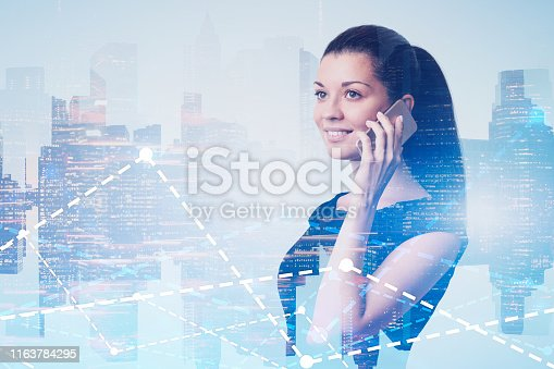 895493084 istock photo Smiling woman on phone in city, graphs 1163784295
