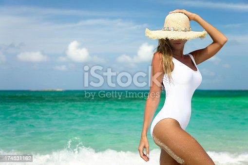 smiling woman on shoreline of tropical beach in the Caribbeanview images from the same series: