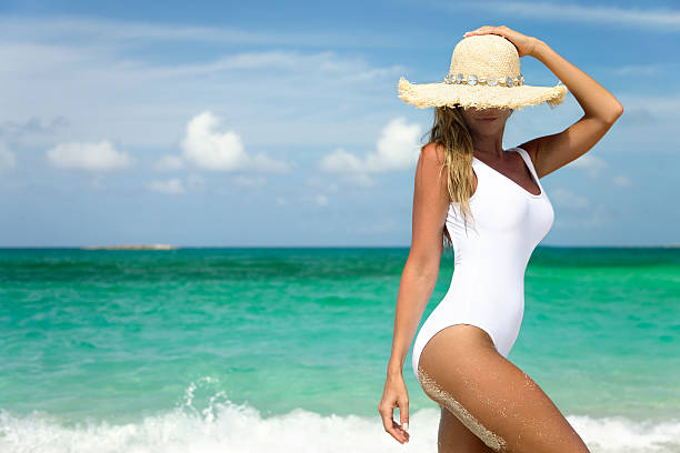 smiling woman on shoreline of tropical beach