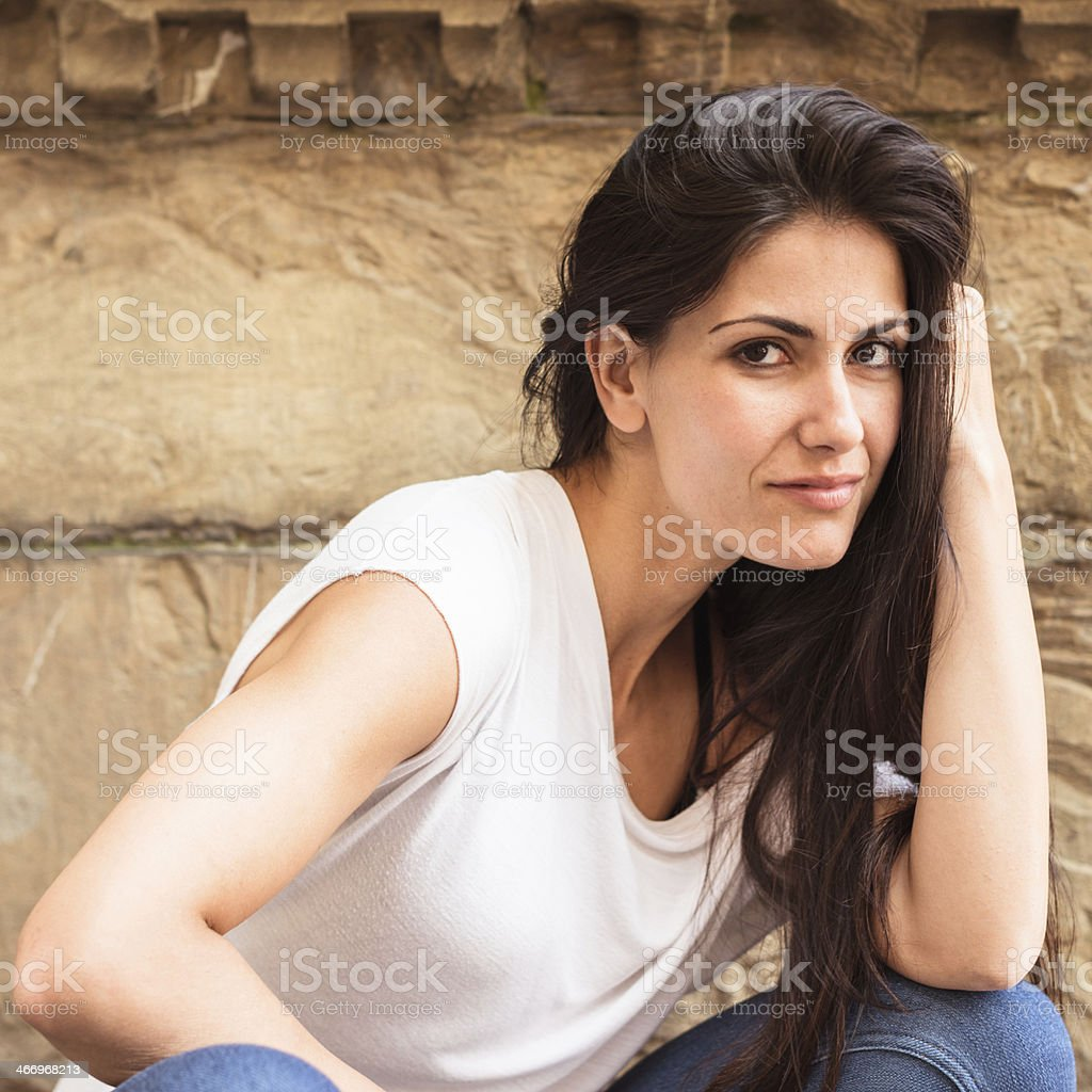 Smiling woman on the city royalty-free stock photo