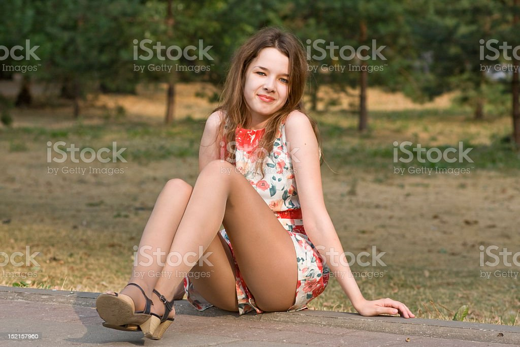 Smiling woman on the edge of a road stock photo