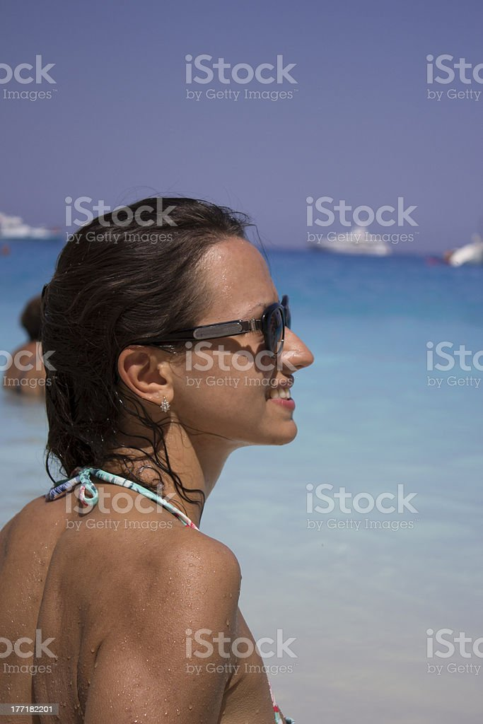 smiling woman on tropical beach royalty-free stock photo