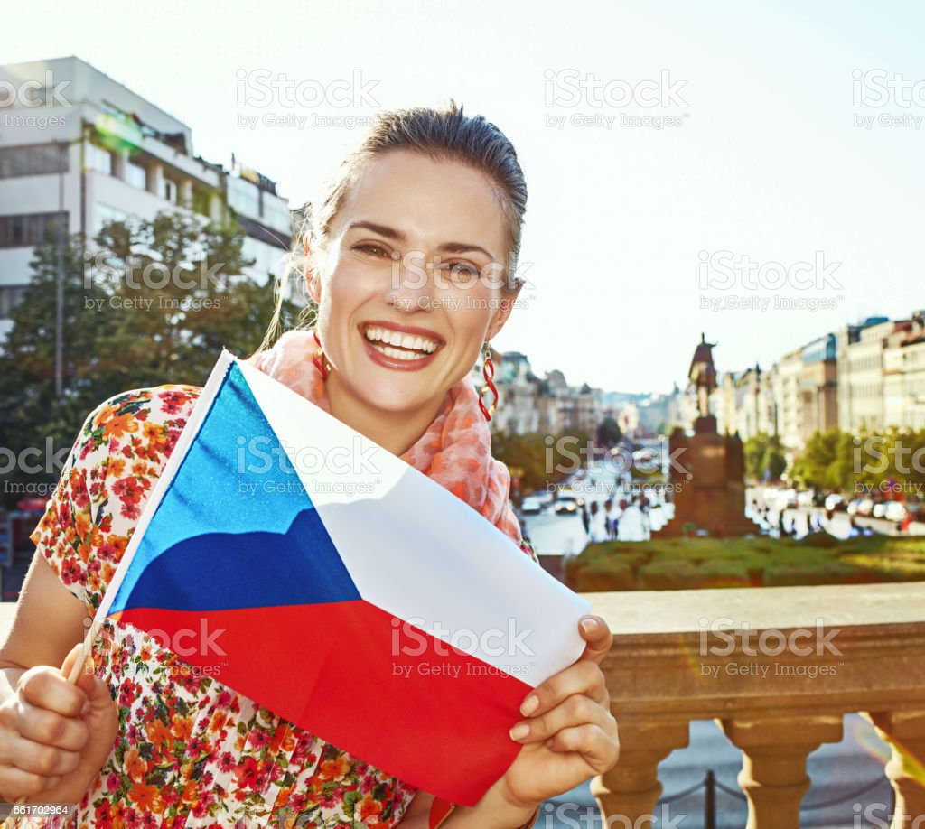 smiling woman on Vaclavske namesti in Prague showing flag stock photo