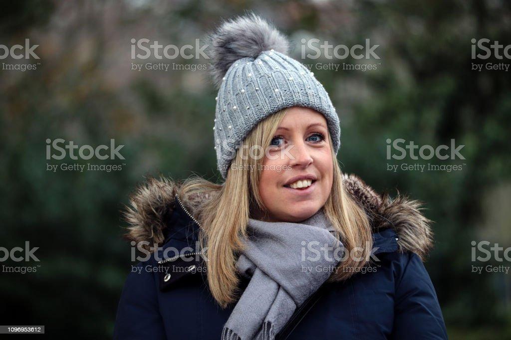 Smiling woman outside stock photo